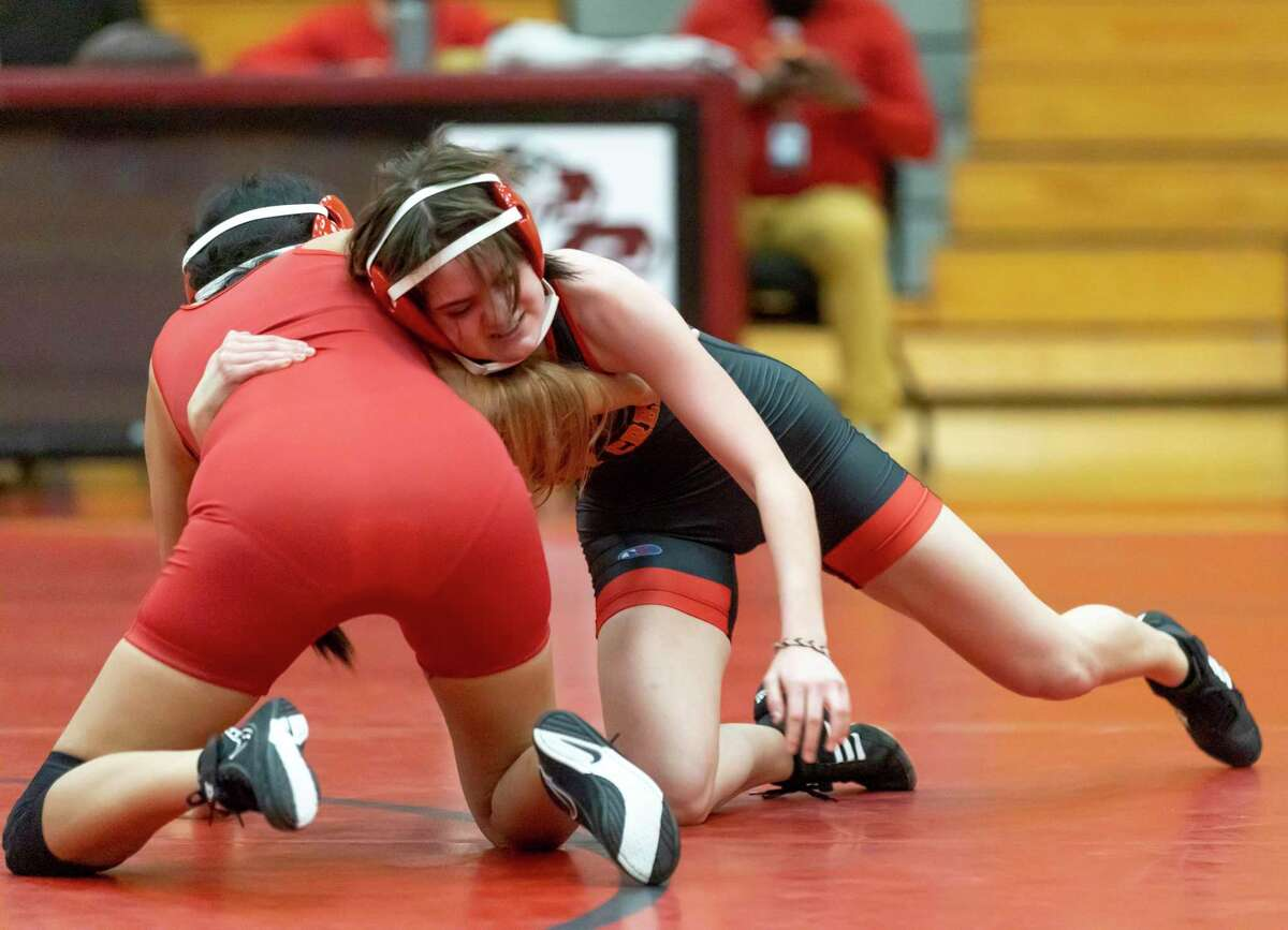 Caney Creek's Skylar Harris, right, attempts to take control of her opponent during a triangular wrestling 110-pound match at Caney Creek High School, Wednesday, March 3, 2021, in Conroe.