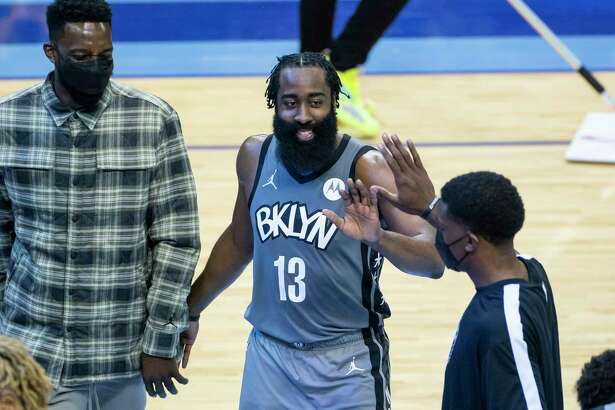 Brooklyn Nets guard James Harden (13) celebrates as he leaves the game during the fourth quarter of a game between the Houston Rockets and Brooklyn Nets on Wednesday, March 3, 2021, at Toyota Center in Houston. The game is the first for Harden against Houston since leaving the team earlier this season.