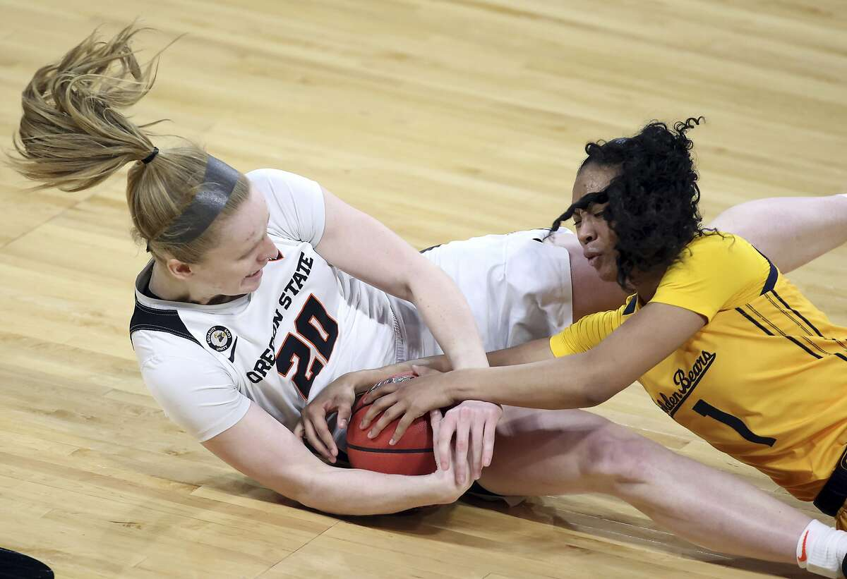 Oregon State's Ellie Mack and Cal's Leilani McIntosh reach for a loose ball during a first-round at the Pac-12 tournament.
