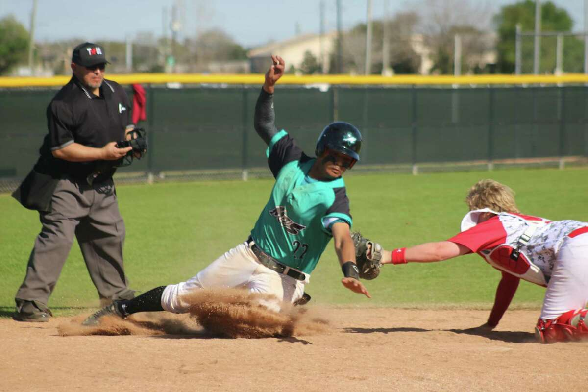 A Memorial runner eludes the tag attempt by the Pasadena-First Baptist Christian Academy catcher during last year's Pasadena ISD Varsity Baseball Tournament. A 32-game schedule is set to go again starting Thursday morning at three campuses and Maguire Field.
