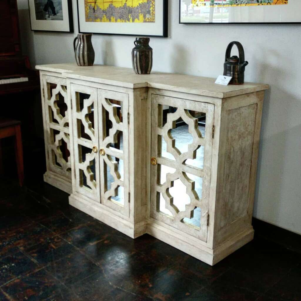 Distressed white TV stand made by The Reclaimed Wood Shop.
