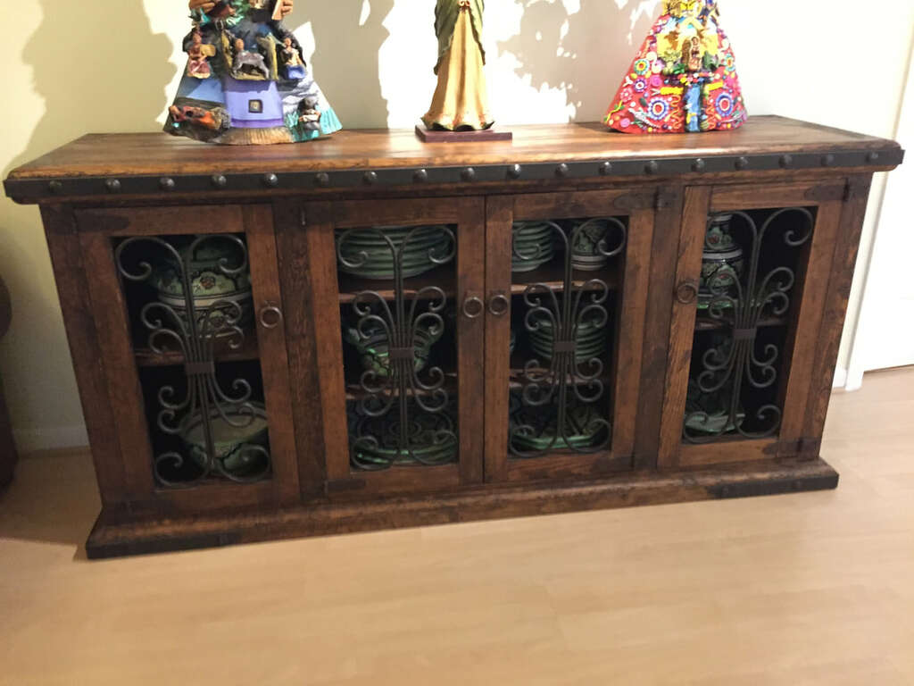 A rustic wood sideboard with metal accents custom-crafted by Rustic 55.