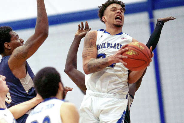 Lewis and Clark's Dakarai Allen scored 19 points to lead the Trailblazers, but they dropped a 98-76 Region 24 decision to Kaskaskia College Wednesday night in Centralia. Allen is shown grabbing a rebound earlier this season.