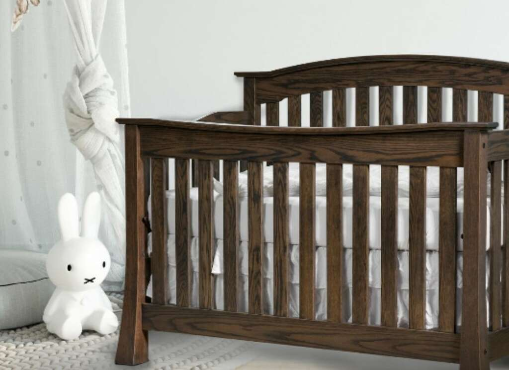 An elegant baby crib for a sweet nursery addition made-to-order at E&G Amish Furniture.