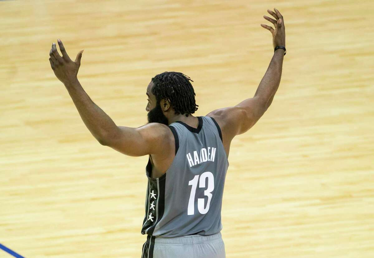 Nets guard James Harden celebrates one of the 14 assists he had in his return to Houston on Wednesday night, part of a triple-double that also included 29 points and 10 rebounds.