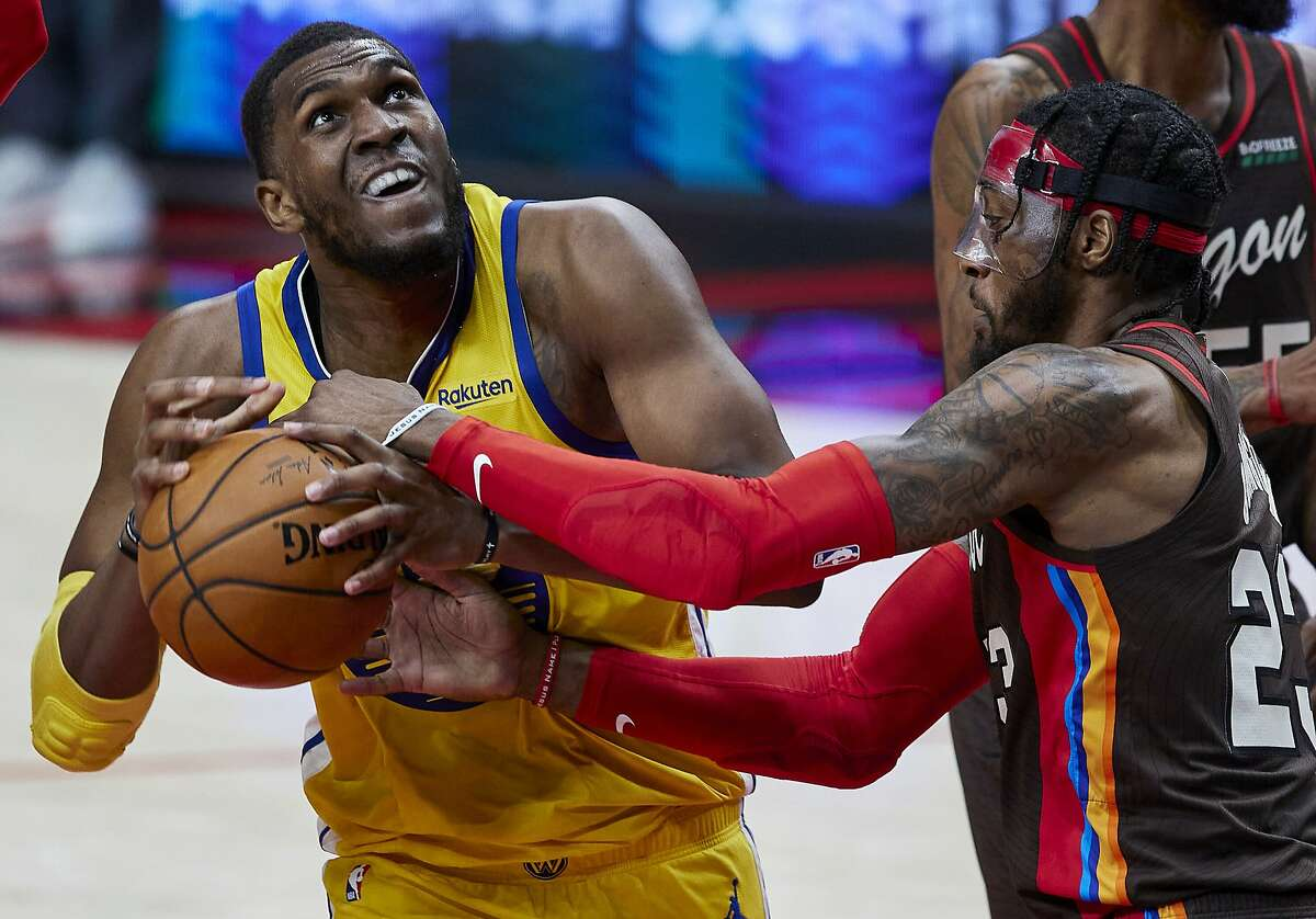 Portland Trail Blazers forward Robert Covington, right, knocks the ball away from Golden State Warriors center Kevon Looney during the first half of an NBA basketball game in Portland, Ore., Wednesday, March 3, 2021. (AP Photo/Craig Mitchelldyer)