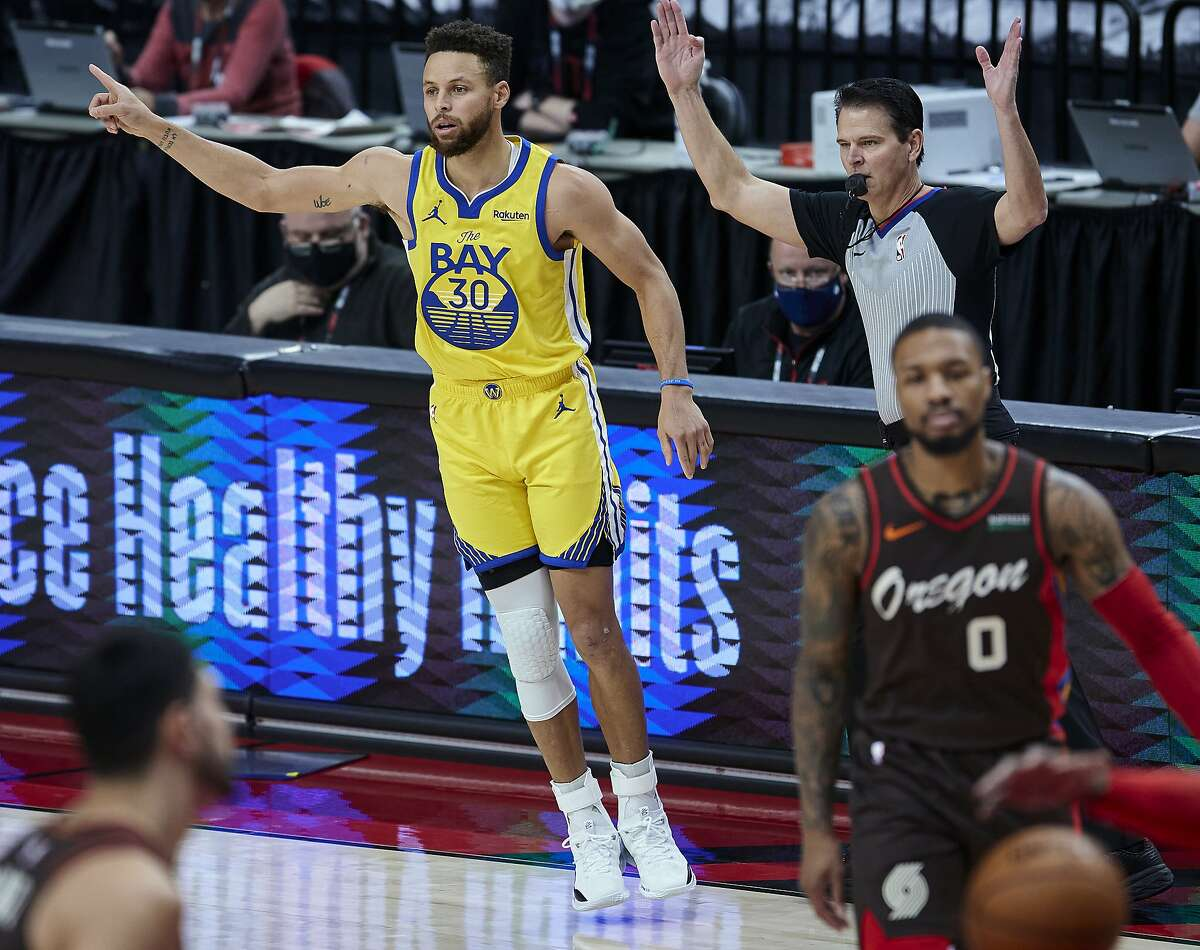 Golden State Warriors guard Stephen Curry reacts after making a 3-point basket against the Portland Trail Blazers during the first half of an NBA basketball game in Portland, Ore., Wednesday, March 3, 2021. (AP Photo/Craig Mitchelldyer)