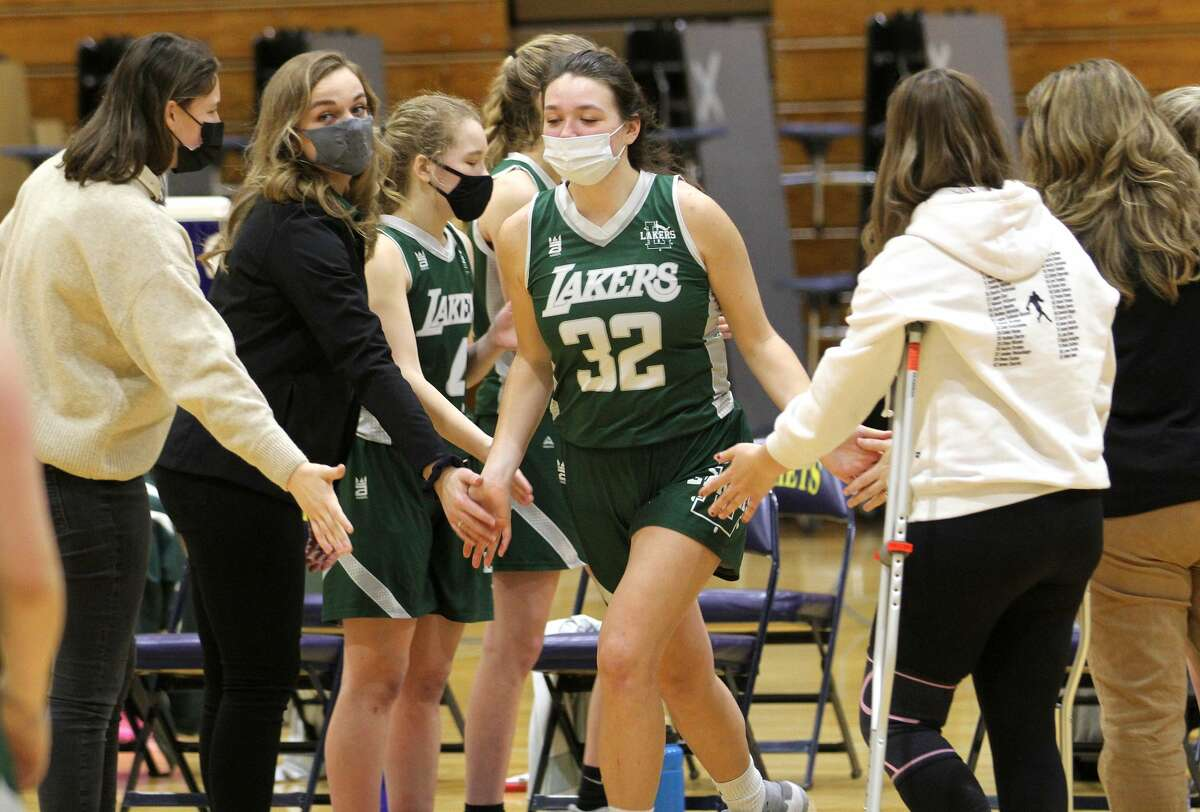 Emma Irion, second from left, returned to her former team to serve as an assistant coach for the Laker girls varsity basketball team this past season. (Tribune File Photo)