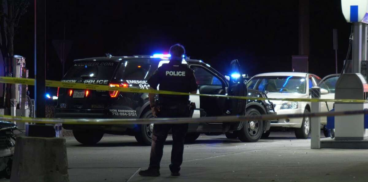 Houston police investigate an officer-invovled shooting Wednesday night at a Chevron gas station. A robbery suspect was killed and a baby was injured in the officer's gunfire.
