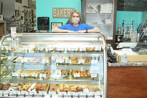 A Little Taste of Heaven owner Lindsey Wulfing (pictured) poses in her bakery on Hillsboro Avenue in Edwardsville. The operation will continue in the city for a short while before moving to its new home at North Center Street in Maryville. That space is currently occupied by Silly Grandma's Sweet Creations, which is moving to Troy under the direction of bakery owner Kathy Hansel.