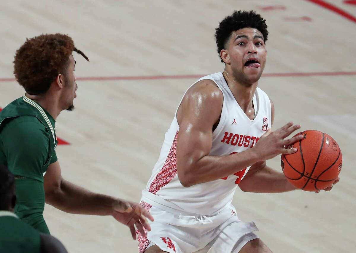 Houston guard Quentin Grimes (24) works the ball to the basket against South Florida during the first half on an NCAA basketball game Sunday, Feb. 28, 2021, at Fertitta Center in Houston.