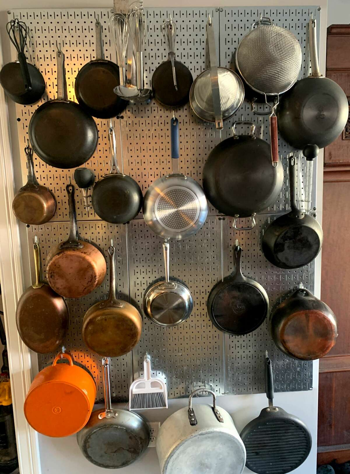 Times Union writer Steve Barnes wanted to have ready access to his pan collection at all times, so he built this pan wall in his Albany apartment.