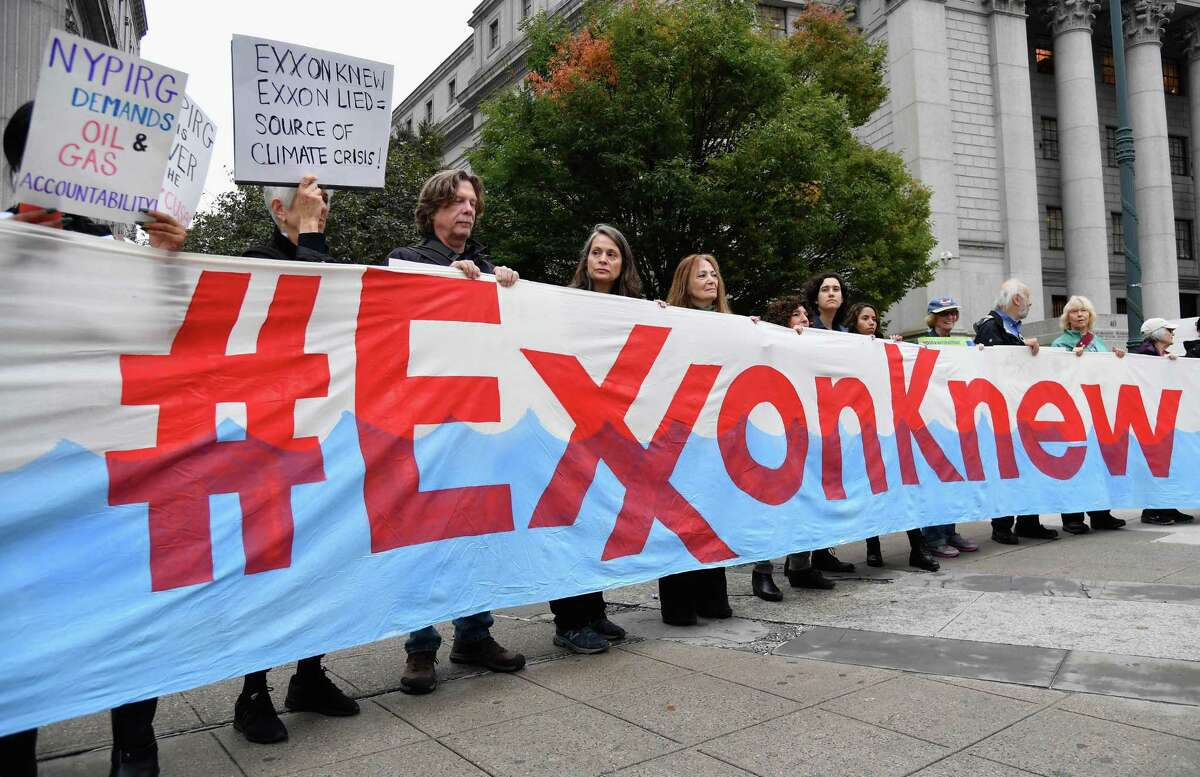 Climate activists protest in New York in 2019. Activist investors are joining the protesters in pressuring oil companies to shift them away from expensive exploration projects, clean up operations and adjust their businesses to the realities of a low-carbon world.