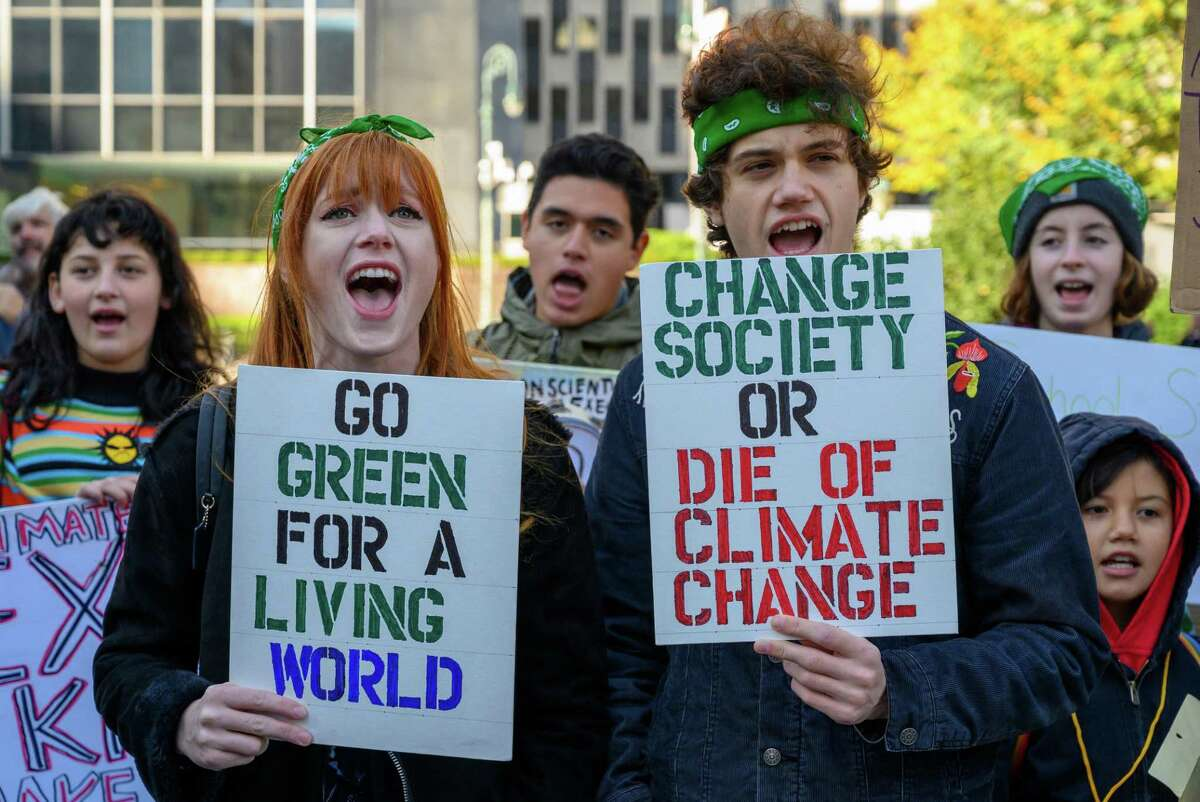 Climate activists protest in 2019. Activist investors are joining the protesters in pressuring oil companies to shift them away from expensive exploration projects, clean up operations and adjust their businesses to the realities of a low-carbon world.