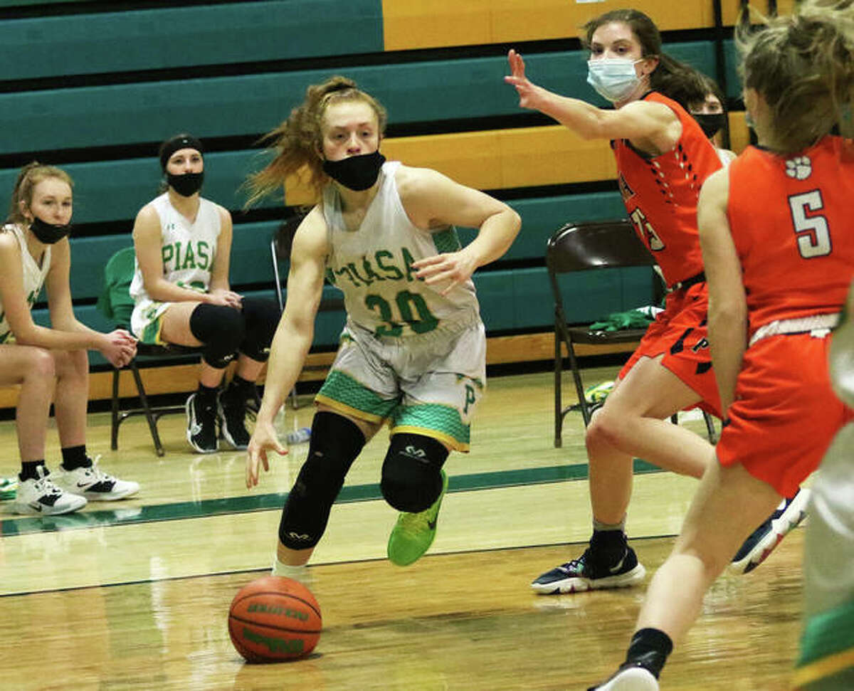 Southwestern's Rylee Smith (left), shown driving to the basket in a Birds' win over Pana on Feb. 19 in Piasa, hit five 3-pointers in another SCC win for the Birds on Wednesday night at Staunton.