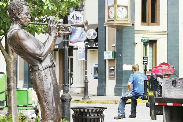 In this file photo, the statue of Miles Davis in Alton seems to be playing a celebratory tune. The statue will be clothed May 1 as part of Skin Cancer Awareness Month.