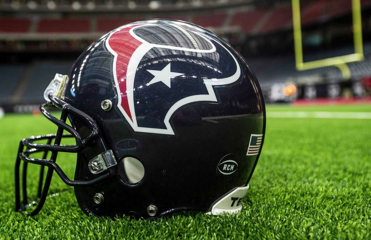 A helmet decal honoring Houston Texans founder Robert C. McNair is placed on the field before an NFL football game against the Tennessee Titans at NRG Stadium on Monday, Nov. 26, 2018, in Houston.