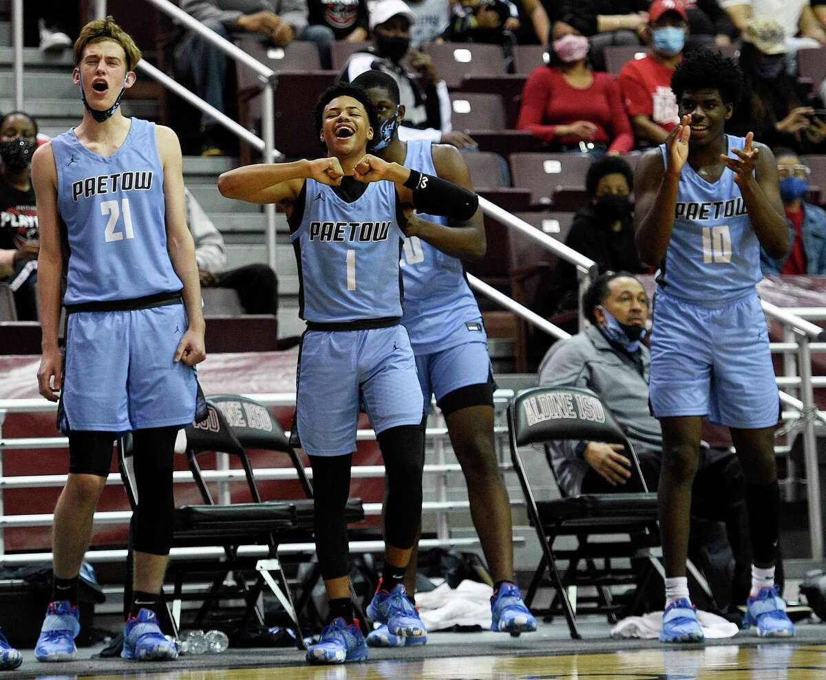 Paetow's Brian McNight (1) and teammates cheer form the bench during the second half of a 5A Region III semifinal high school basketball playoff game against Goose Creek Memorial, Tuesday, March 2, 2021, in Houston.