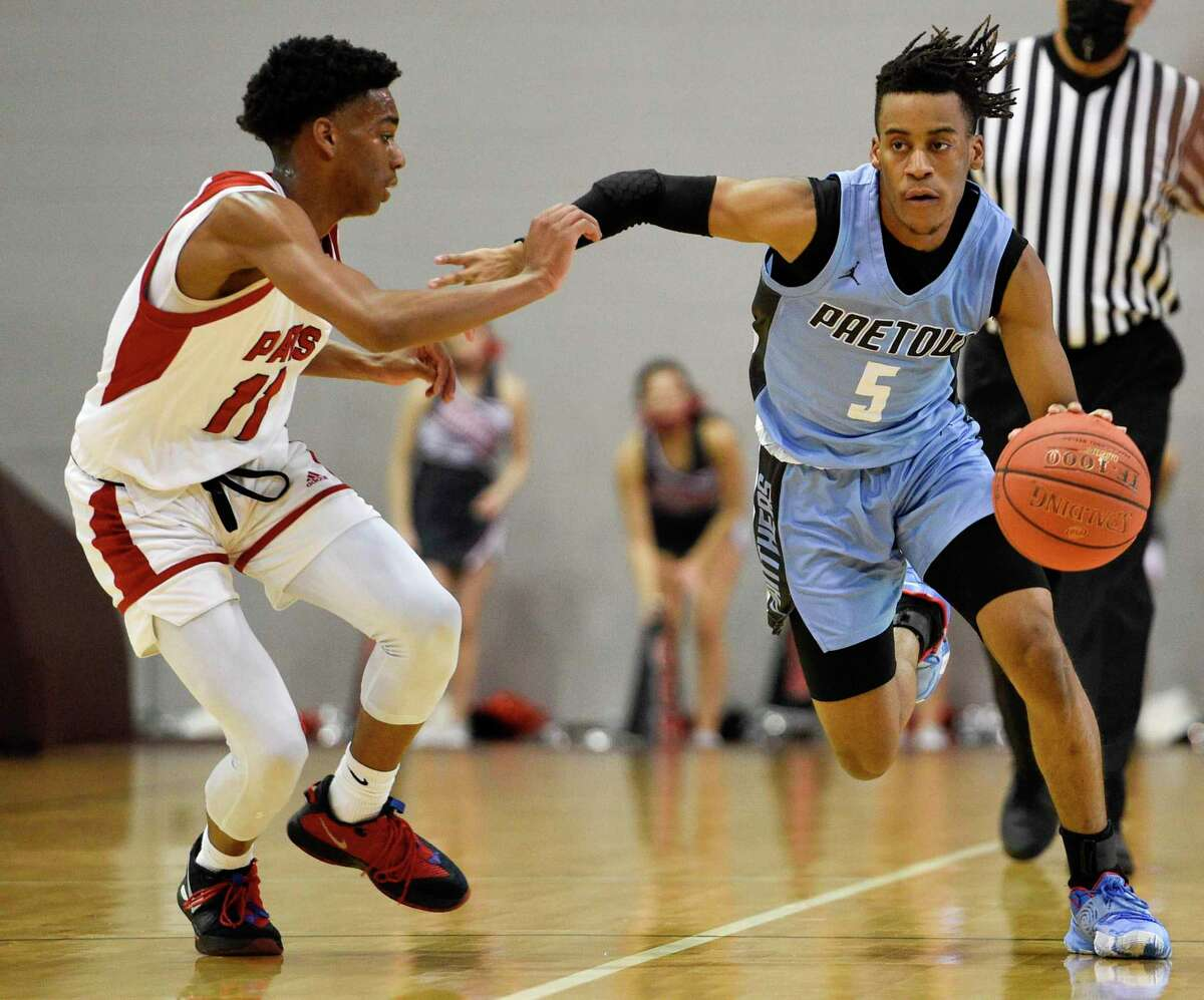 Paetow's Jayden McCullough (5) dribbles past Goose Creek Memorial's Avant Coleman during the first half of a 5A Region III semifinal high school basketball playoff game, Tuesday, March 2, 2021, in Houston.