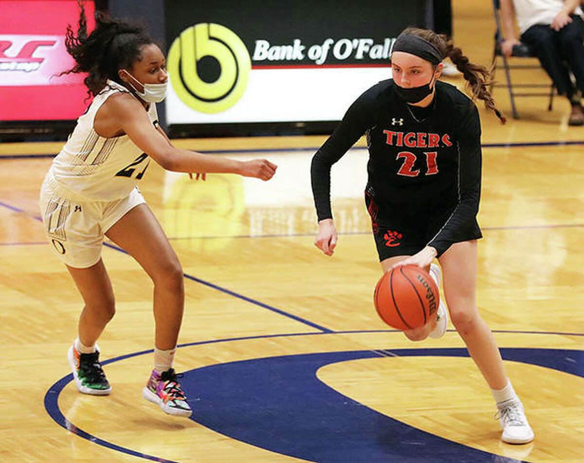 Edwardsville's Elle Evans dribbles the ball near center court while being guarded by O'Fallon's Shannon Dowell in the second half of Wednesday's game in O'Fallon.