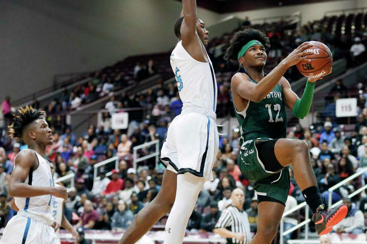 Hightower guard Bryce Griggs, right, drives up a shot past Shadow Creek guard Will Young, left, and guard Shawn Jones, middle during the Class 5A Region III finals basketball game, held at the M.O. Campbell Education Center Saturday, Mar. 7, 2020 in Houston, TX.