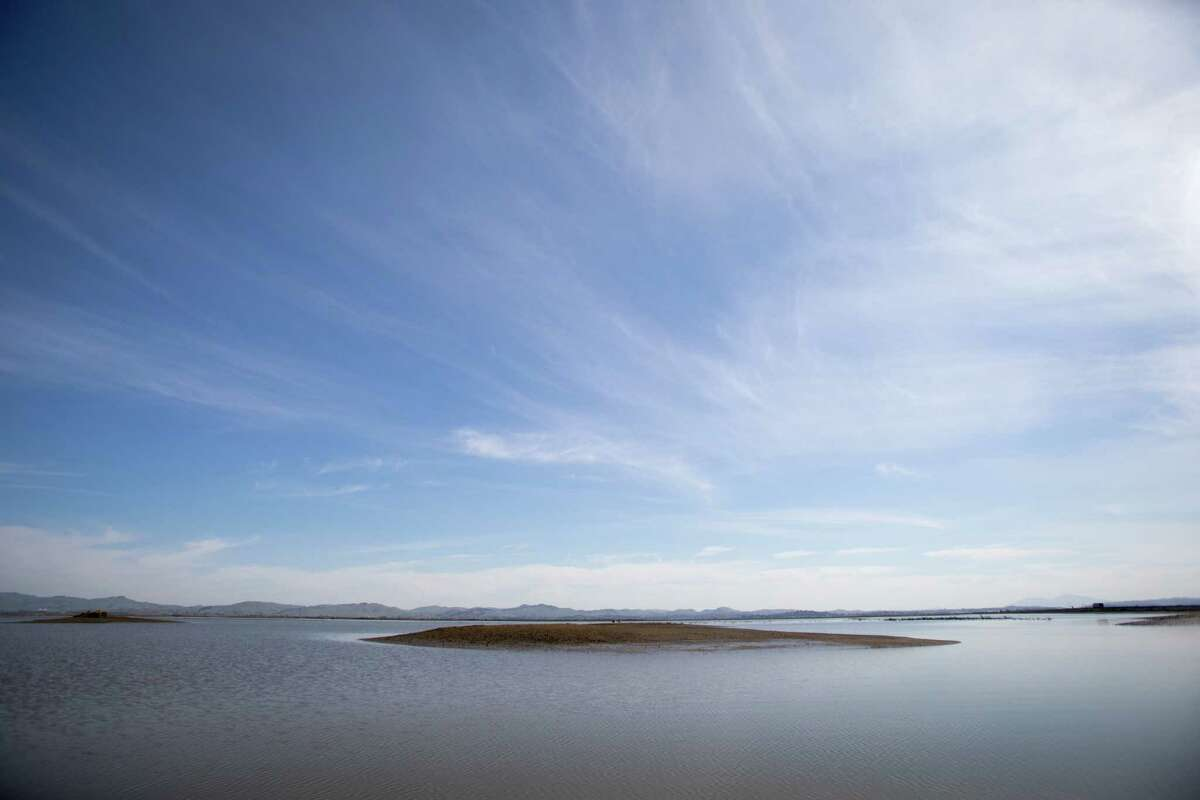 An island of sediment is visible at low tide at Cullinan Ranch near Vallejo, Calif., on March 3, 2021. Part of San Pablo Bay National Wildlife Refuge, Cullinan Ranch is former farmland that is being restored into a tidal marsh.