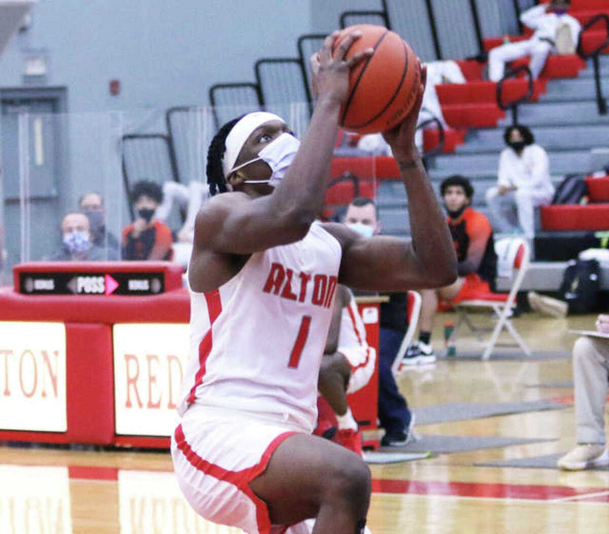 Alton's Ja'Markus Gary goes in for a layup during a Feb. 20 SWC game against Edwardsville at Alton High in Godfrey. On Wednesday night in Belleville, Gary scored a career-high 32 points in a SWC loss to Belleville West.