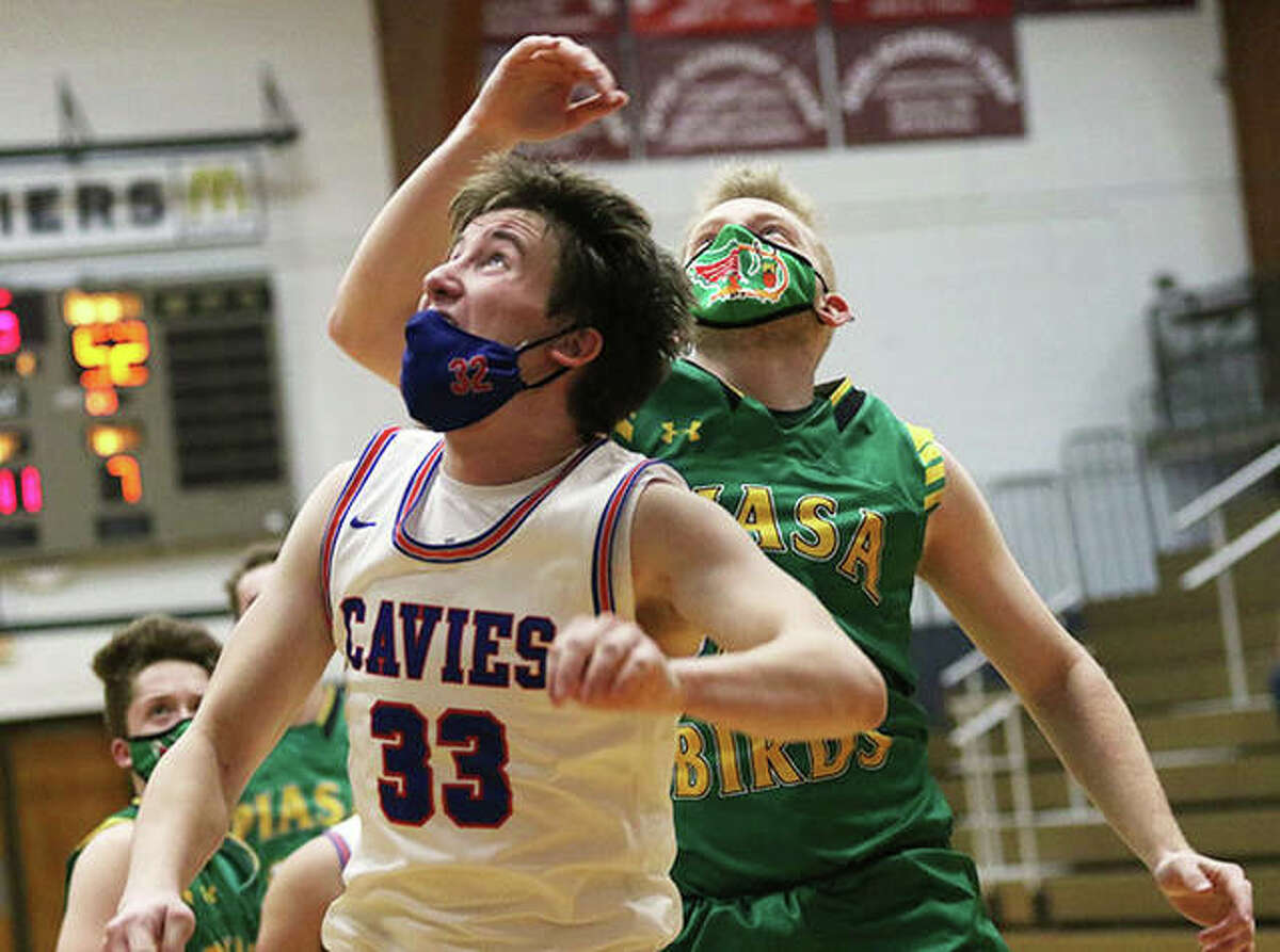 Carlinville's Aaron Wills (33) and Southwestern's Brady Salzman watch Wills' shot during a Feb. 24 game in Carlinville. On Wednesday night, Wills scored 10 points in a Cavaliers' loss to Greenville, while Salzman had 10 rebounds in a Piasa Birds' OT win over Staunton.