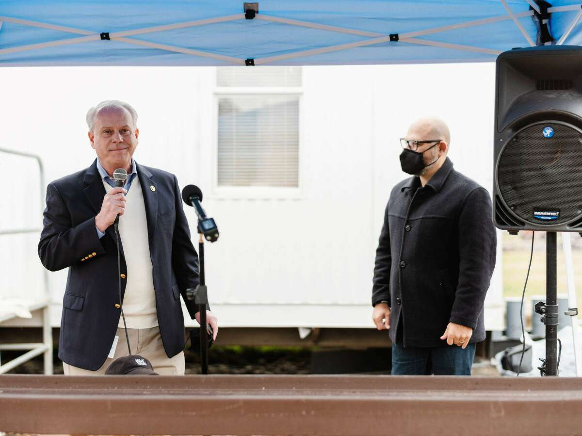 Vincent Morales, Fort Bend County Commissioner- Precinct 1 and Brandon Baca, CEO of Attack Poverty speaking during the beam-signing ceremony.