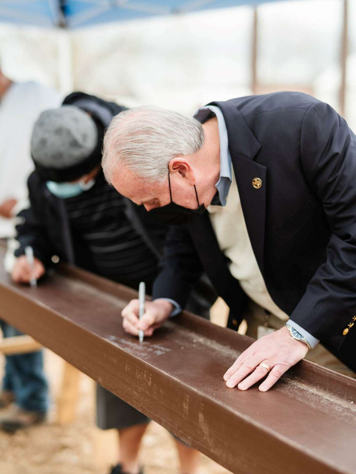 Attack Poverty's new community center in Rosenberg is currently under construction. A beam-signing event took place Feb. 5, 2021.