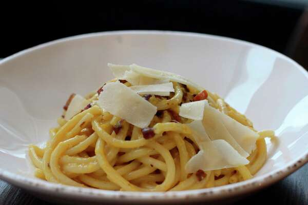 Bucatini carbonara, spaghetti served in a creamy egg and cheese based sauce served with pancetta (cured pork belly), is one of the specialty pasta dishes available at Vita Bella. (Courtesy Photo)
