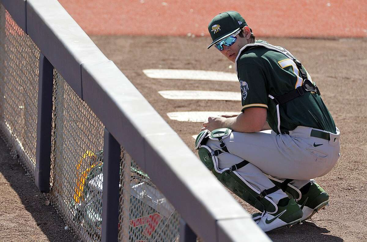Tyler Soderstrom (77) in the bullpen as the Oakland Athletics played the Milwaukee Brewers at American Family Field in Phoenix, Ariz., on Tuesday, March 2, 2021.