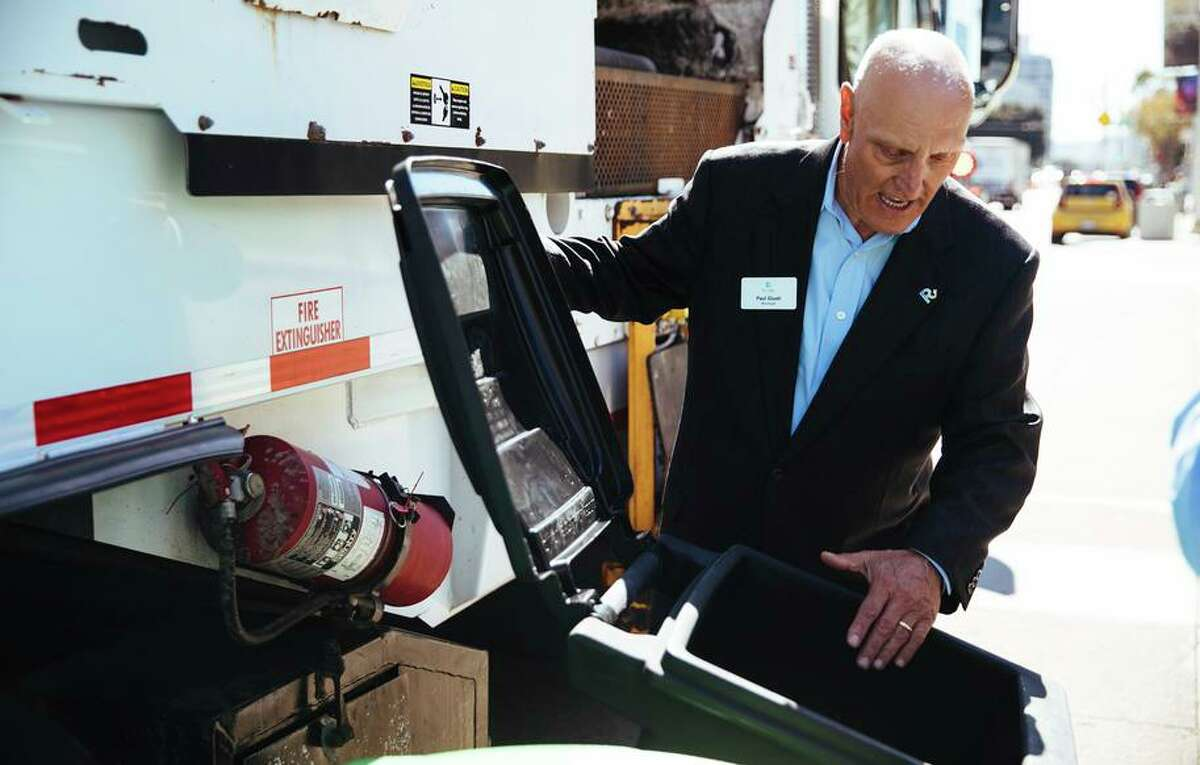 Paul Giusti, Community and Government Affairs Manager at Recology, shows off the smaller 16-gallon waste bins in San Francisco, Calif. Thursday, October 5, 2017.