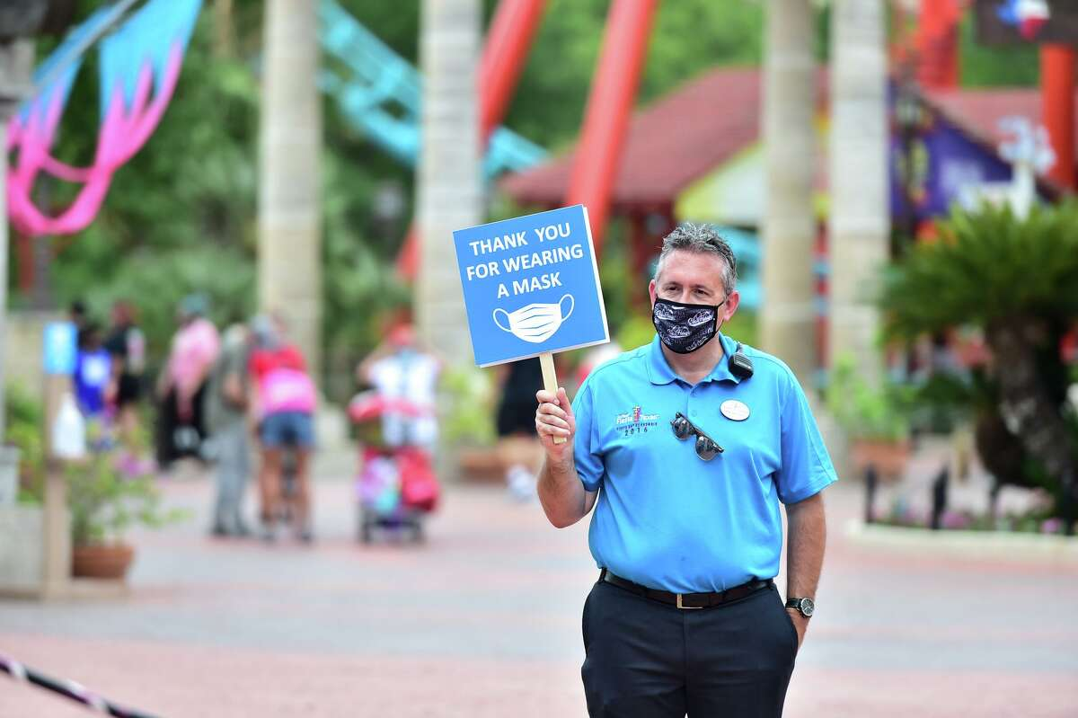 Park President Jeffrey Siebert greets guests Sunday during Six Flags post-pandemic opening weekend. Numerous COVID safety protocals have been instituted at the park.