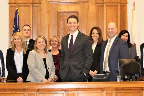 Madison County State's Attorney Tom Haine, center, has announced his leadership team. Pictured, from left, are Trent Cameron, Katie Warren, Andy Carruthers. Maria Maxwell, Susan Jensen, Haine, Lauren Maricle, Chad Loughrey, Kathleen Nolan and Sean Williams
