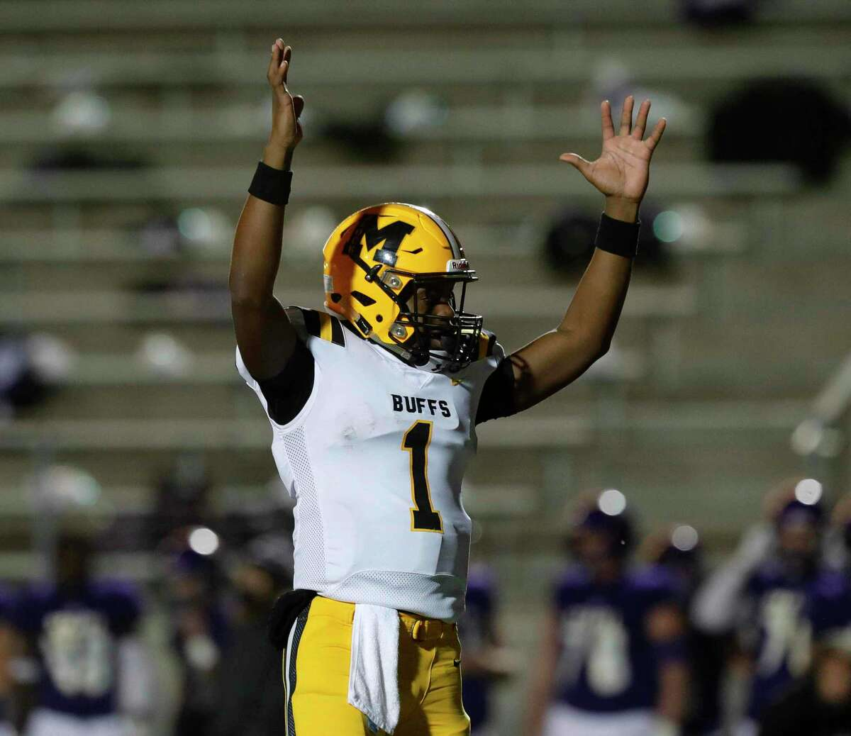 Fort Bend Marshall quarterback Roland Harvey (1) reacts after running back Jy'Adrian Wortham's 3-yard touchdown run during the second quarter of a Region III-5A area high school playoff football game at Randall Reed Stadium, Friday, Dec. 18, 2020, in New Caney.