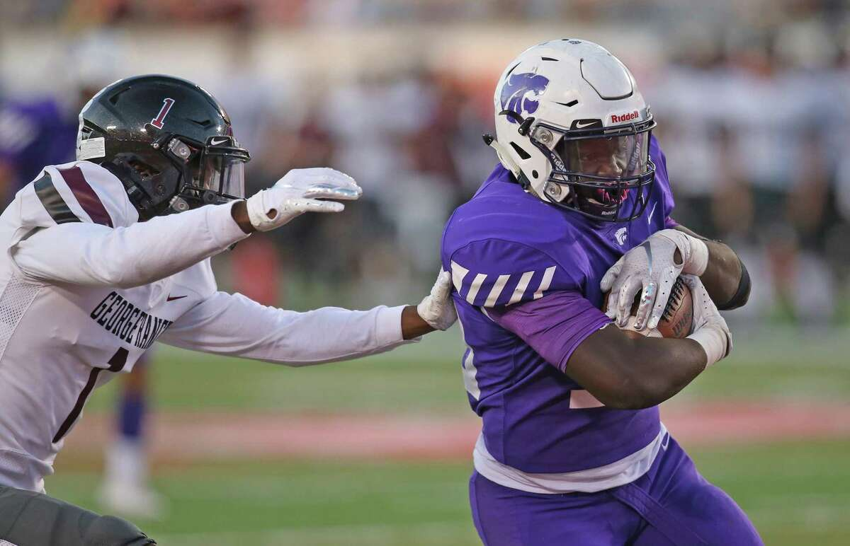 Humble Wildcats running back X'Zavier Sidney (30) is pursued by George Ranch Longhorns defensive back Stephen Woods (1) in the first half in a high school playoff football game on November 23, 2019 at TDECU Stadium in Houston, TX.