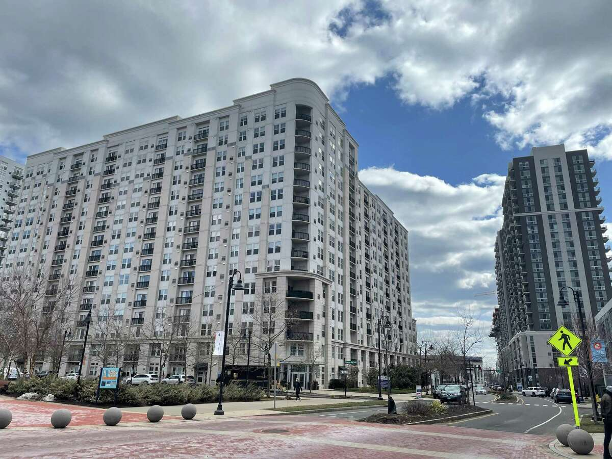 The apartment building, at left, at 101 Washington Blvd., aka 101 Park Place, in the Harbor Point section of Stamford, Conn., has sold for $105 million.