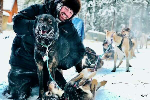 Jeremy Traska is shown with a few of the dogs at Howling Ridge Kennel in Two Rivers, Alaska. His wife, Shaynee Traska, transferred her team spot to him, and he will be running the 49th Annual Iditarod beginning Sunday, March 7. (Photo Provided)