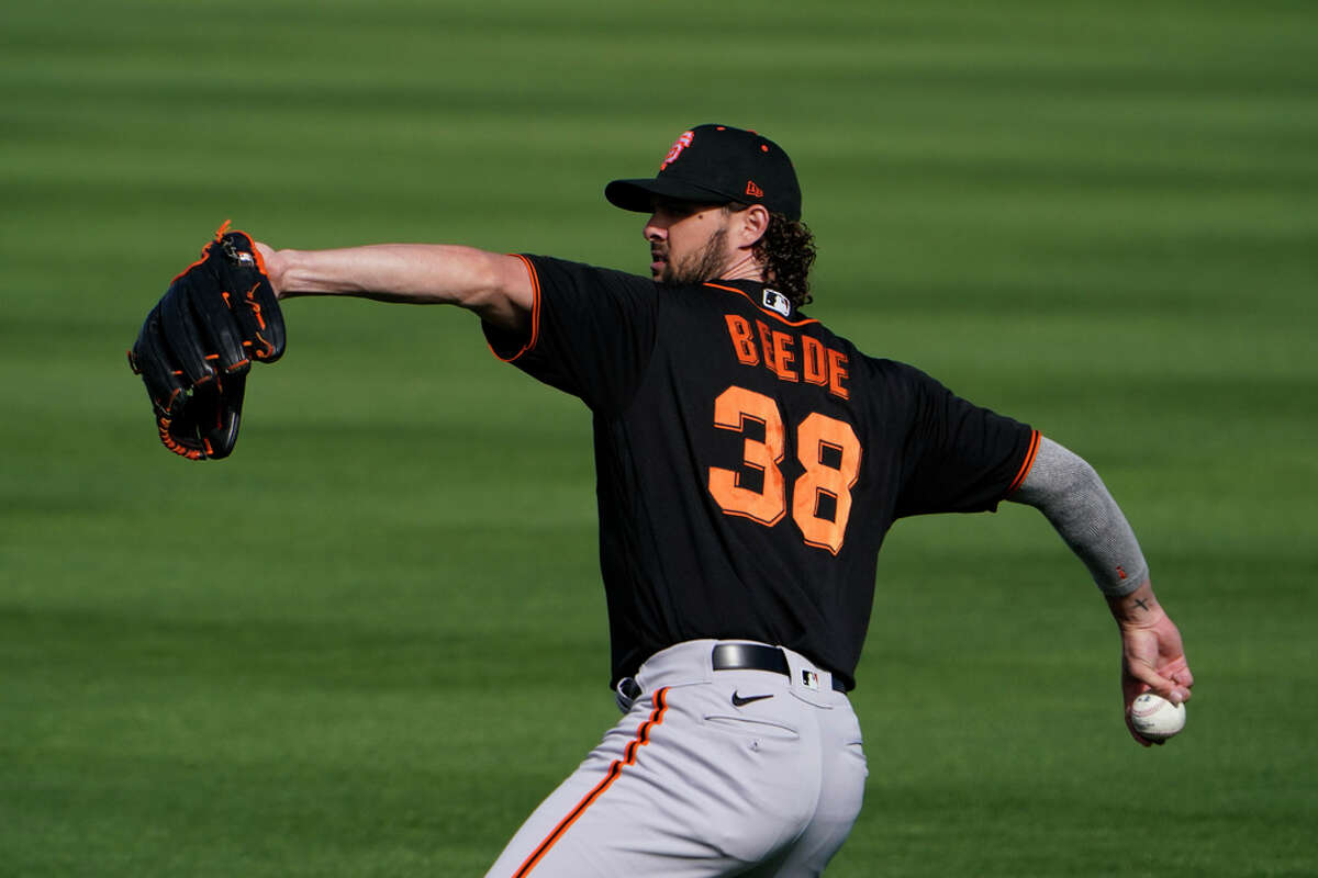 Giants pitcher Tyler Beede throws the ball during the team's spring training baseball workout in Scottsdale on Feb. 26.