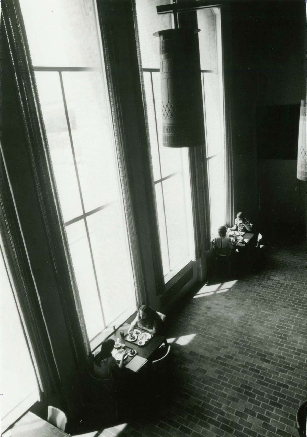 In an undated photo, Beaumont Mood Lighting fixtures hang over the Refectory (now Mabee Dining Hall) on the campus of Trinity University