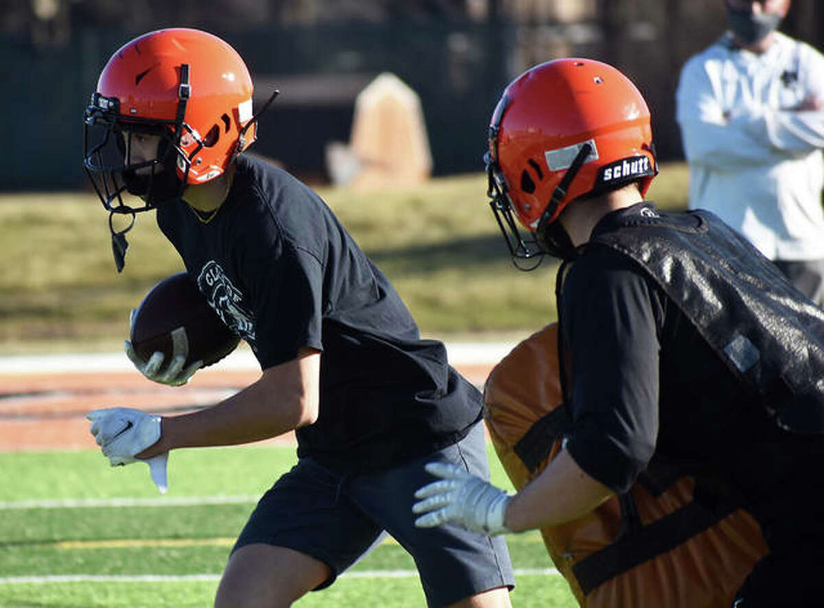 Edwardsville senior Grant Matarelli runs past a defender during a drill on Wednesday inside the District 7 Sports Complex.