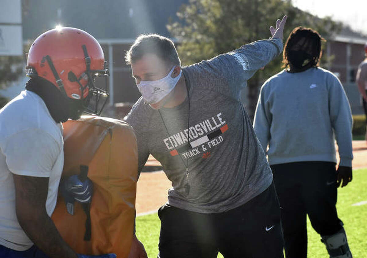 Edwardsville coach Matt Martin instructs his players how to complete a drill during Wednesday's practice.