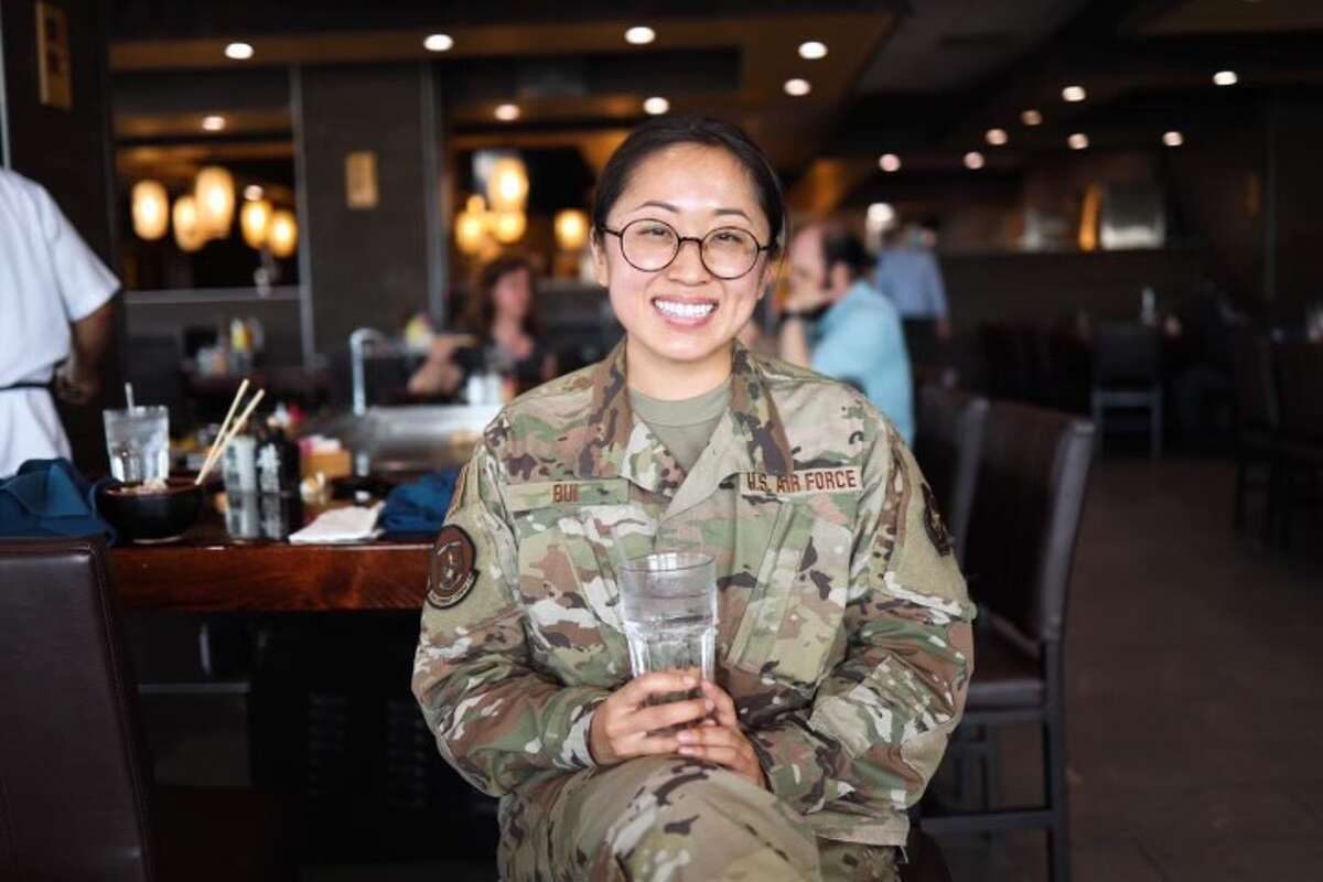 """Bui, a 31-year-old Air Force reservist, has a fully remote day job developing training material for a company called Serco. After work, she'd rush to the restaurants to beat sundown in order to snap a few photos of the food. She spent time after the shoot meeting the owners to collect their stories and struggles for a Facebook post on her page. """"No hidden costs, no hidden fees, no hidden agenda, I just donate my time,"""" she said."""