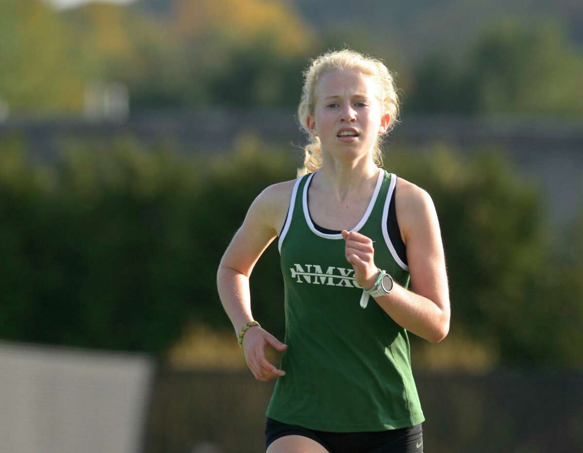 New Milford's Maddie Sweeney runs during a 2020 meet.
