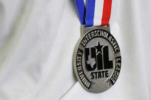 Lauren Burch of The Woodlands wears her medal after finishing second overall in the Class 6A girls 1-meter diving during the UIL State Swimming & Diving Championships, Monday, March 1, 2021, in San Antonio.