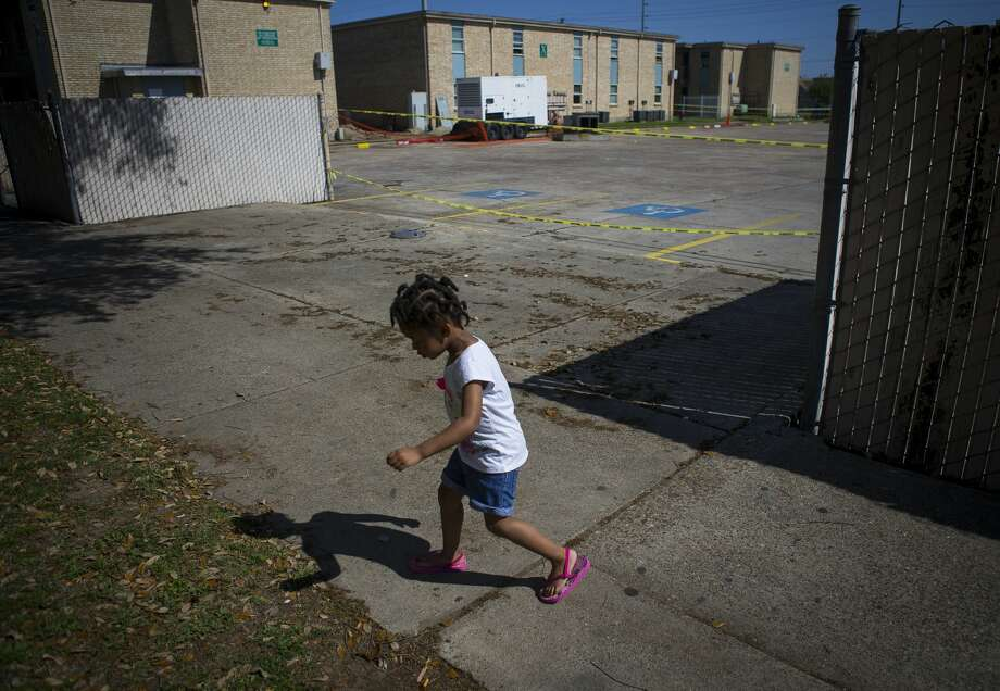 Three-year-old Peyton Johnson plays in front of her home at the Sandpiper Cove apartments, which are privately owned but subsidized by HUD. Photo: Mark Mulligan/Staff Photographer / ? 2019 Mark Mulligan / Houston Chronicle