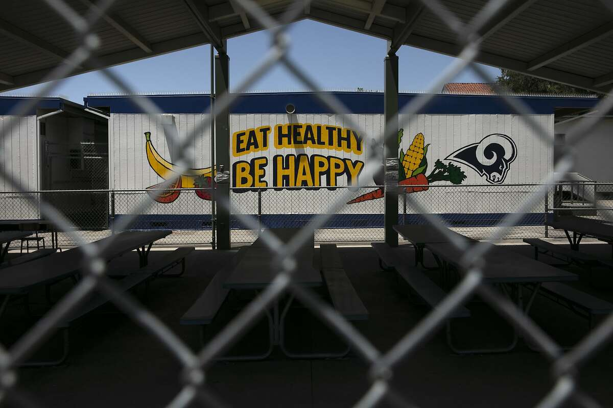 The cafeteria area of an elementary school is seen through a fence in Los Angeles on July 17, 2020.