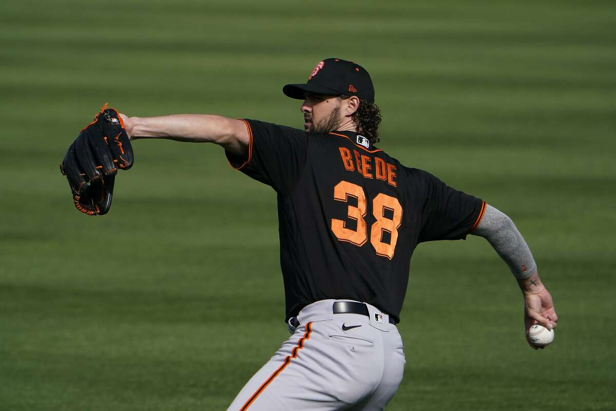 San Francisco Giants pitcher Tyler Beede throws the ball during the team's spring training baseball workout in Scottsdale, Ariz., Friday, Feb. 26, 2021. (AP Photo/Jae C. Hong)