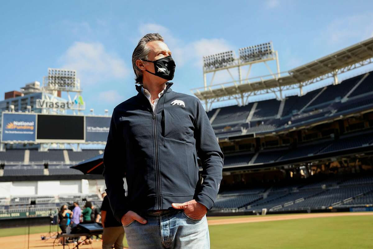 Gov. Gavin Newsom before a press conference last month at San Diego's Petco Park, which hosts a vaccination site. Newsom says fans could be attending major-league games by next month.